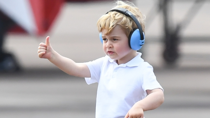 Prince George in noise canceling headphones