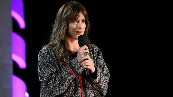 Actress Dakota Johnson speaks onstage during