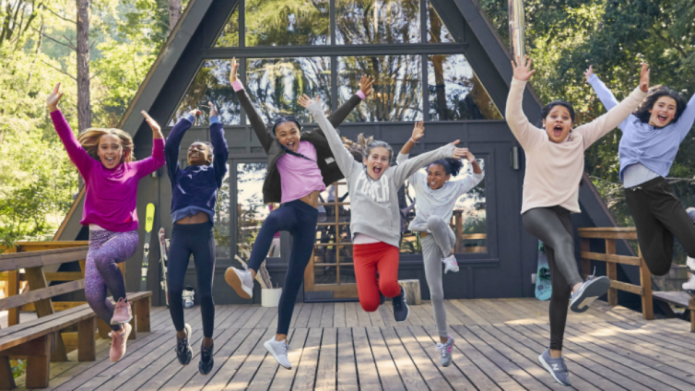Seven girls jumping into the air