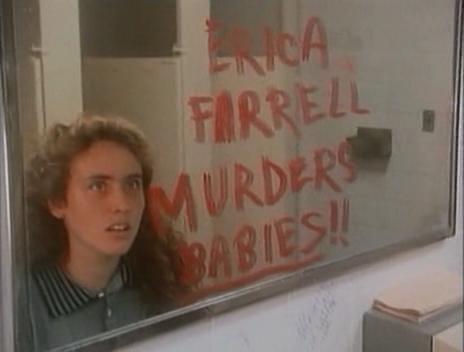 """Woman looking in mirror which has """"Erica Farrell Murders Babies"""" written on it."""