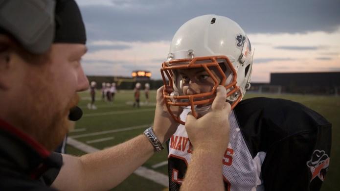 kid wearing football helmet