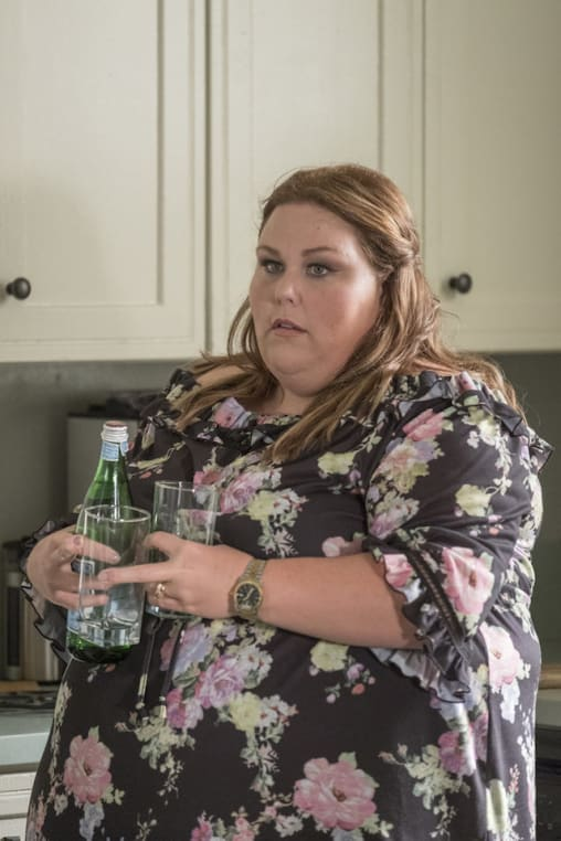 Kate (Chrissy Metz) stands alone in the kitchen.
