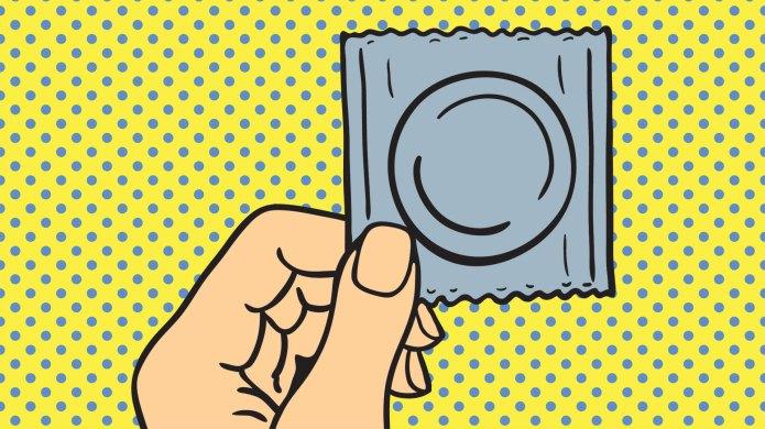 Hand holding condom pop art illustration