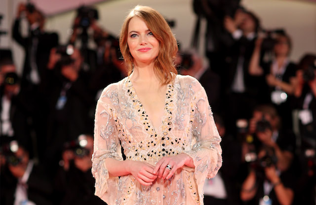 Emma Stone walks the red carpet ahead of the 'The Favourite' screening during the 75th Venice Film Festival at Sala Grande