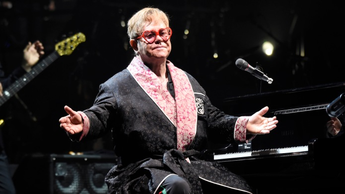 Elton John performs onstage during his