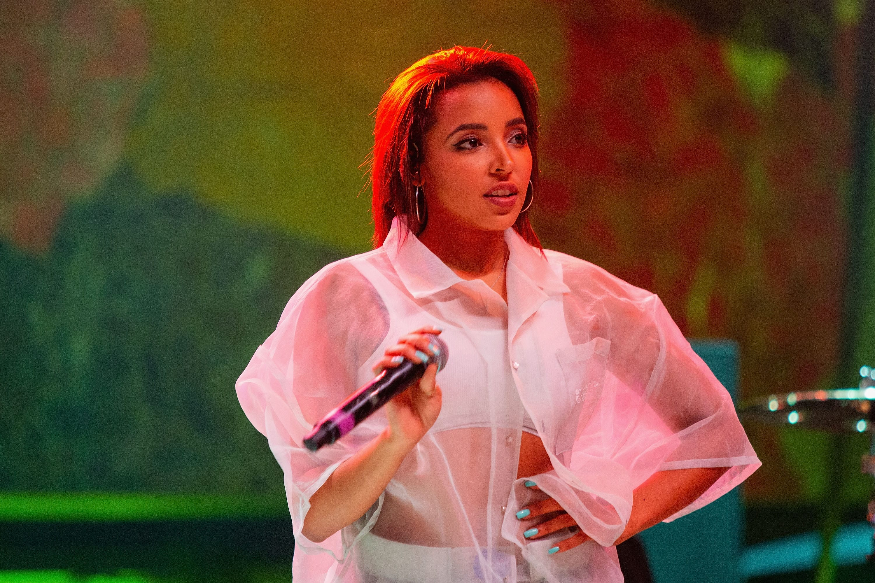 Photo of R&B singer Tinashe in concert