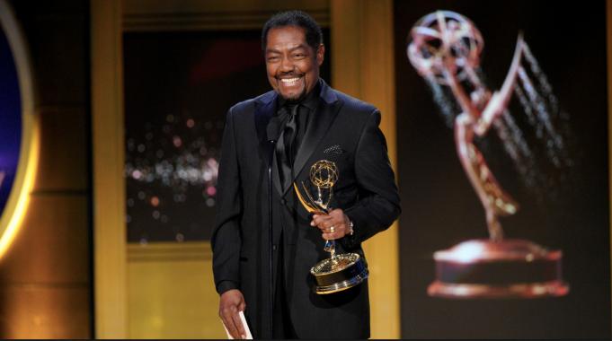 James Reynolds holding Daytime Emmy