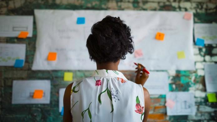 Woman looking at notes