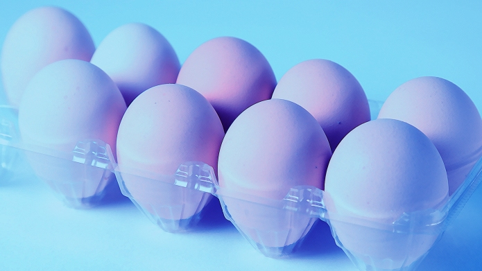 Carton of eggs with a blue
