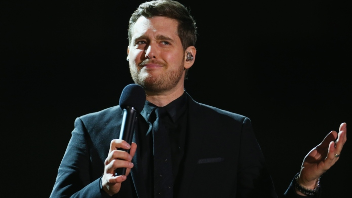 Michael Buble performing at a concert.