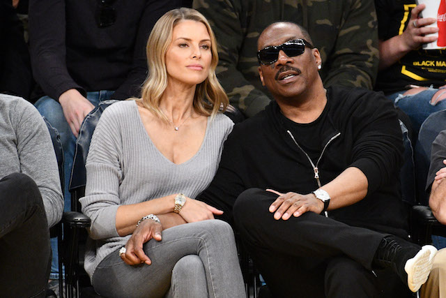 Eddie Murphy and actress Paige Butcher attend a basketball game between the Los Angeles Lakers and the Utah Jazz at Staples Center