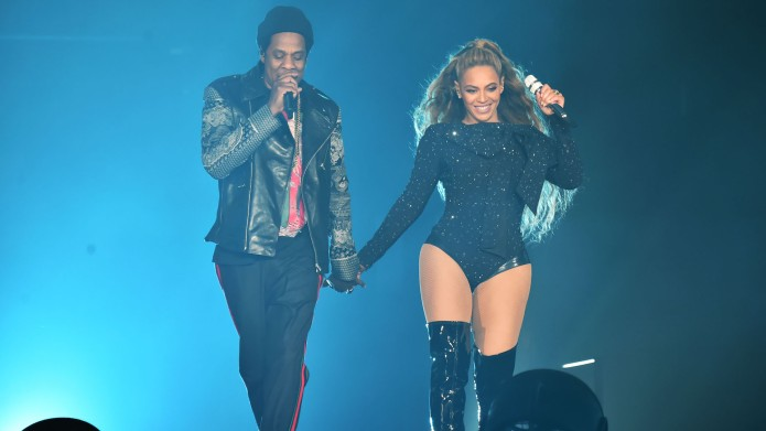 Beyonce and Jay-Z perform together holding