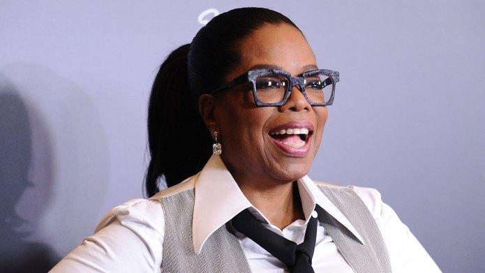 Oprah Winfrey smiling wearing glasses