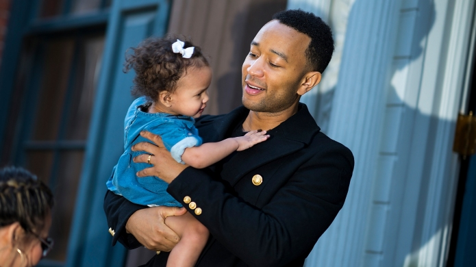 photo of john legend holding luna
