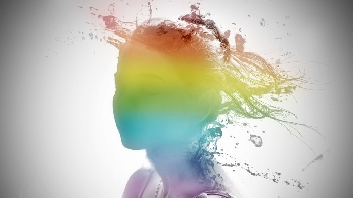 Woman's head with a rainbow face.