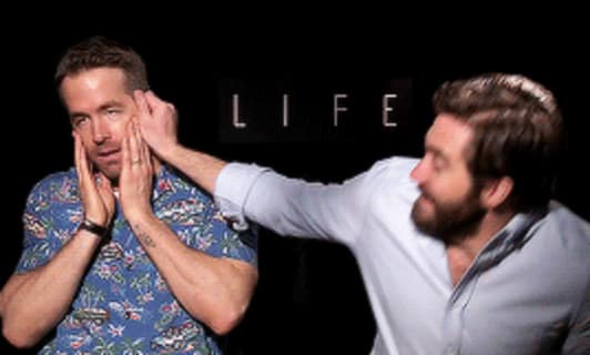 Gif of Ryan Reynolds and Jake Gyllenhaal doing press for 2017 movie 'Life'