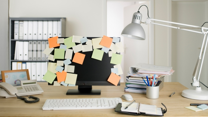 Computer screen covered in Post-It notes