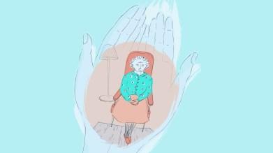 Woman holding smaller elderly woman sitting