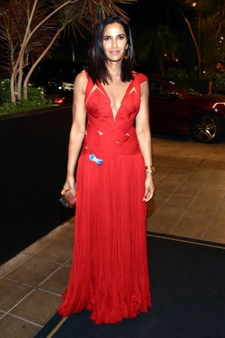 Padma Lakshmi standing up wearing a red dress
