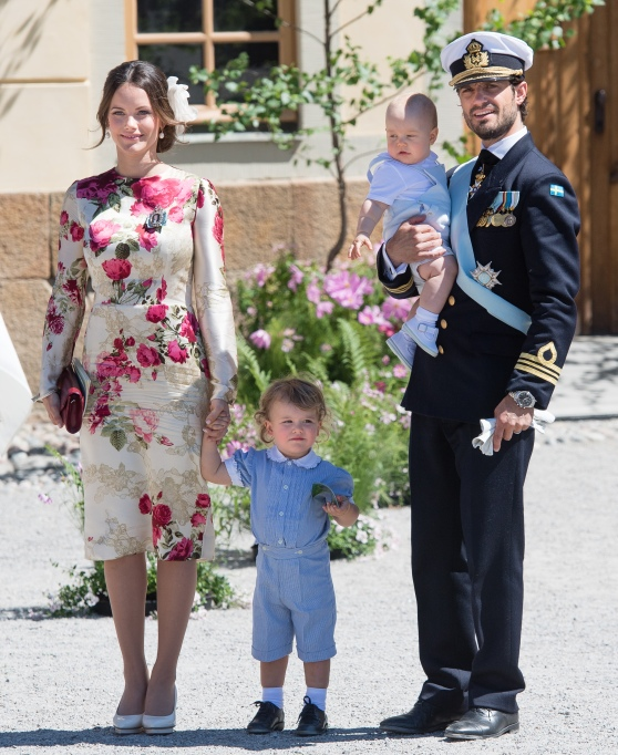 Princess Sofia, Prince Alexander and Prince Carl Phillip (holding Prince Gabriel) pose after the christening of Princess Adrienne of Sweden
