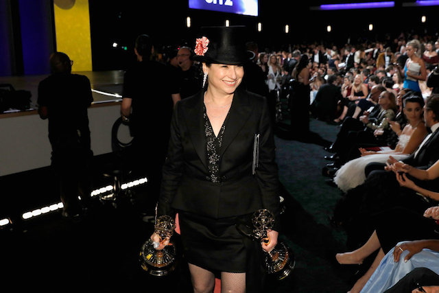 Photo of Amy Sherman-Palladino holding her two Emmys at the 70th Annual Emmy Awards