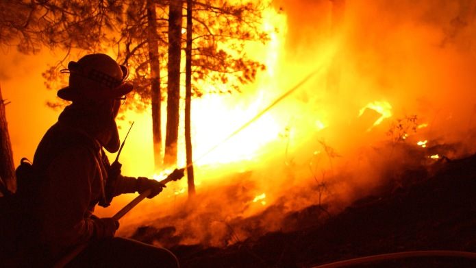 Firefighter putting out wildfire