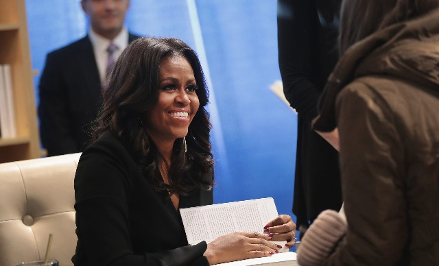 Michelle Obama kicks off her 'Becoming' book tour with a signing at the Seminary Co-op bookstore on November 13, 2018, in Chicago, Illinois.