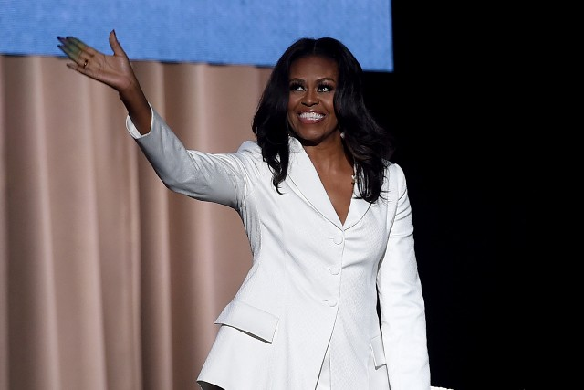 Michelle Obama appears onstage at Becoming: An Intimate Conversation with Michelle Obama at the Forum
