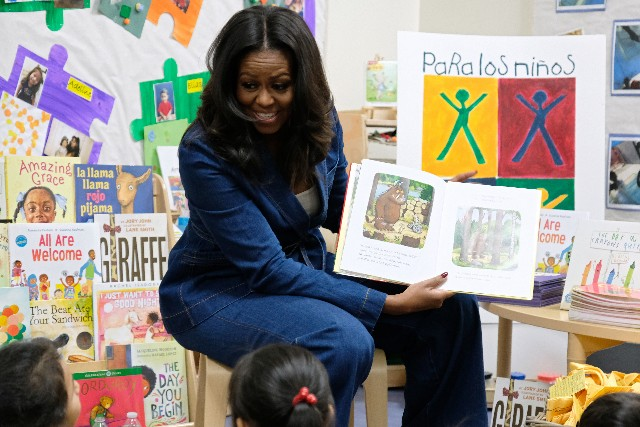Former First Lady Michelle Obama reads to students at Para Los Niños