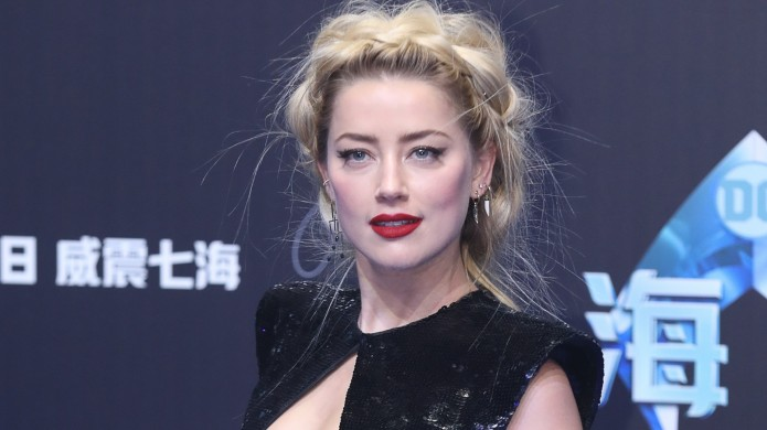 Amber Heard attends the premiere of