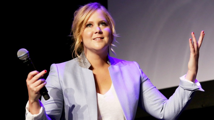 photo of amy schumer on stage
