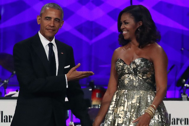 President Barack Obama and First Lady Michelle Obama arrive to address the Congressional Black Caucus Foundation's 46th Annual Legislative Conference