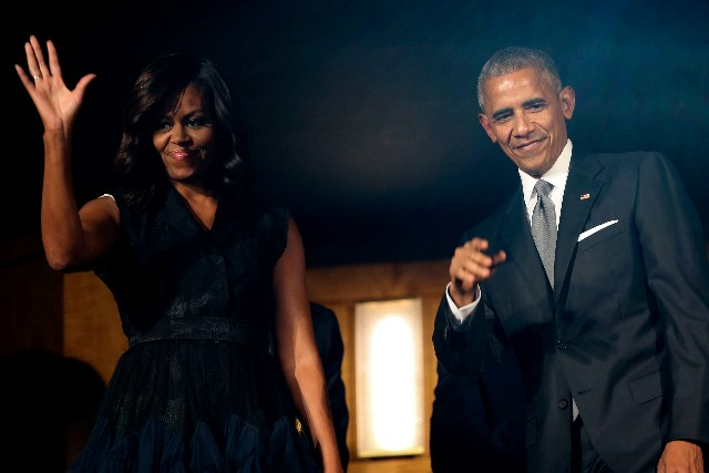 President Barack Obama and first lady Michelle Obama attend a performance at the Kennedy Center September 23, 2016, Washington, DC. The 'Taking the Stage; African American Music and Stories That Changed America' performance celebrates the opening of the Smithsonian National Museum of African American History and Culture