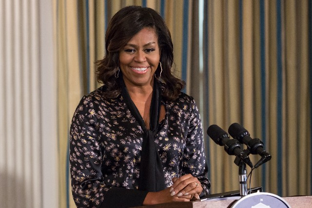 Michelle Obama speaks to students during a Grammy Museum musical workshop.