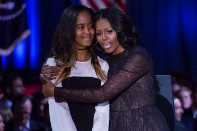 Malia Obama, and her mom, first lady Michelle Obama, share a hug onstage, after U.S. President Barack Obama delivered his farewell address to the American people at McCormick Place Convention Center.