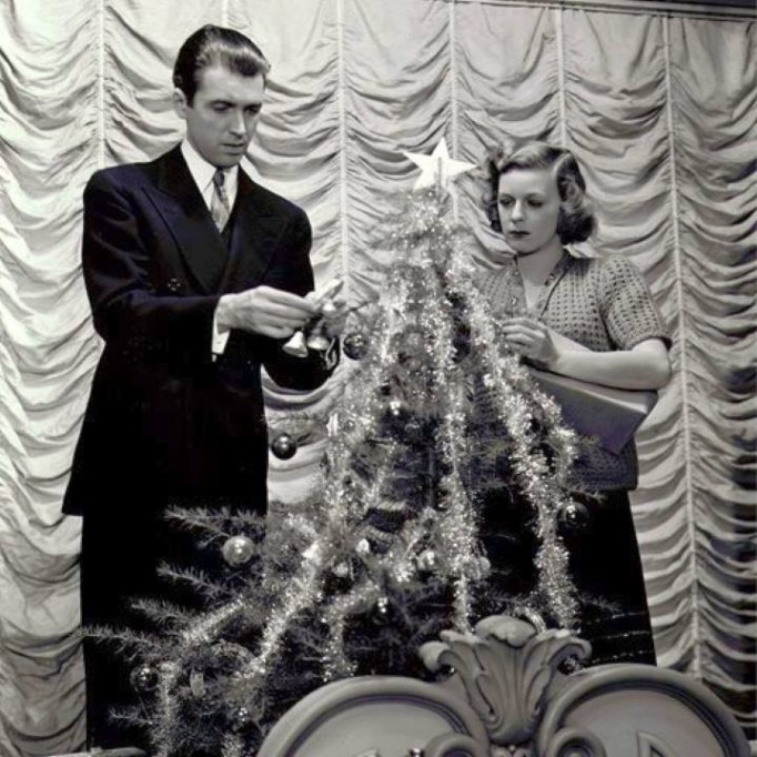 Jimmy Stewart and Margaret Sullavan decorate a tree in 'The Shop Around the Corner'