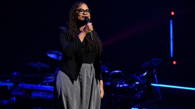 Ava DuVernay holding microphone