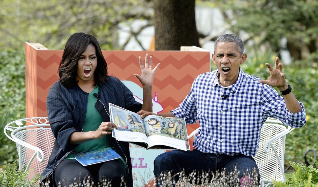 "WASHINGTON, DC - MARCH 28: (AFP OUT) President Barack Obama (R) and first lady Michelle Obama (L) imitate monsters as they read ""Where the wild things are""during the White House Easter Egg Roll on the South Lawn of the White House March 28, 2016 in Washington, DC. The tradition dates back to 1878 when President Rutherford B. Hayes allowed children to roll eggs on the South Lawn. (Photo by Olivier Douliery-Pool/Getty Images)"