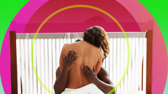 Woman's bare back being held by