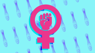 Female symbol and raised fist on