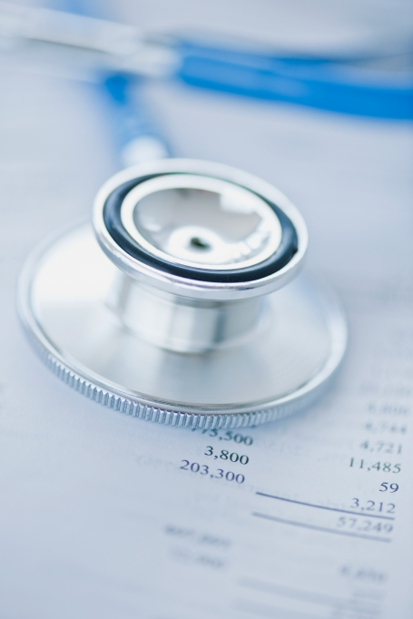 Stethoscope on some financial papers