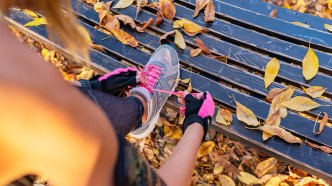 Woman tying shoe on bench during
