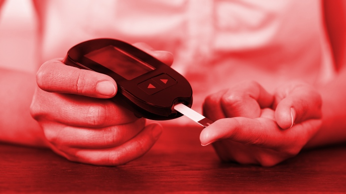 Woman pricking finger for blood sugar