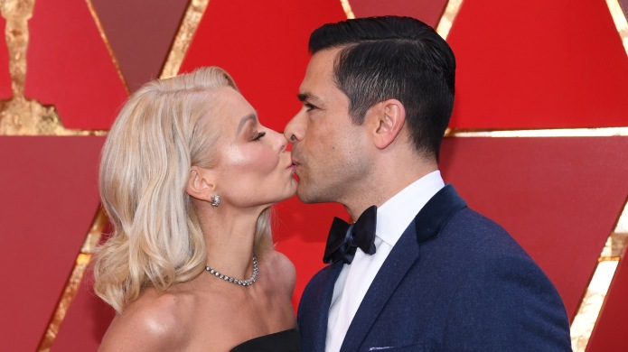 Kelly Ripa and Mark Consuelos attend