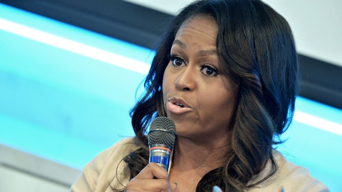 Michelle Obama speaking into a microphone