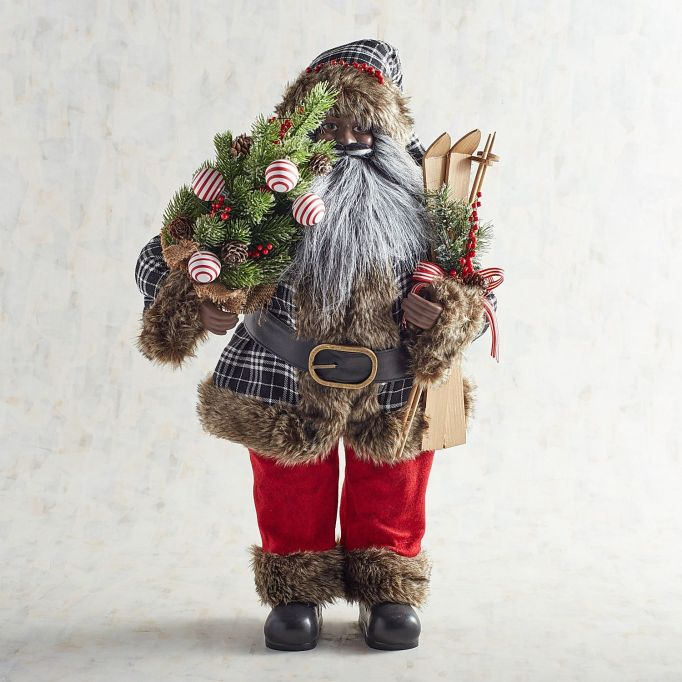 Black and white plaid African-American Santa figurine.