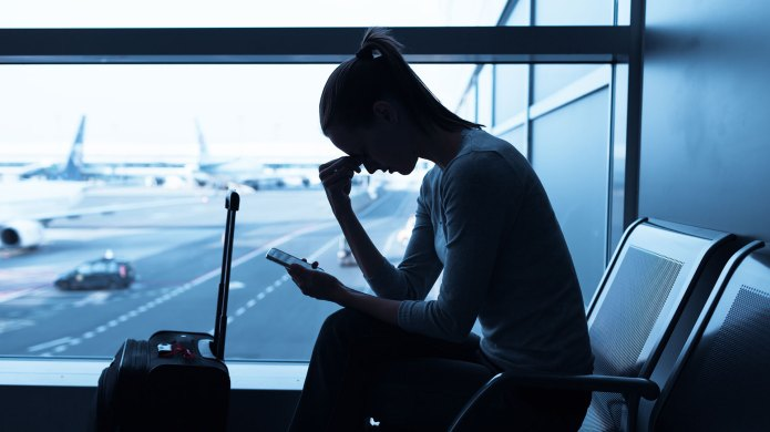 Woman stressed at airport