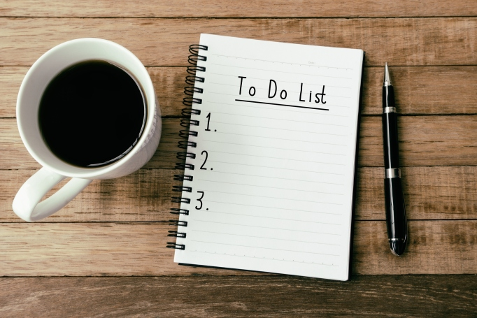 Pen, coffee and notebook with to-do list