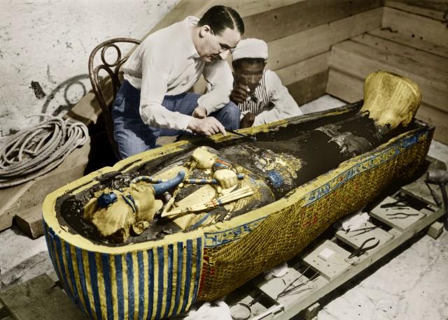 Howard Carter (1873-1939), English Egyptologist, near golden sarcophagus of Tutankhamen (mummy) in Egypt in 1923