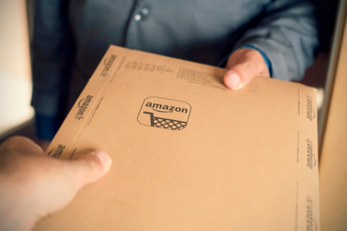Person delivering Amazon package to recipient